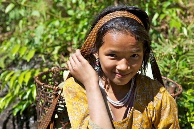 Mishmi girl with a basket of pumpkins. Singa, Yangsang Pemako
