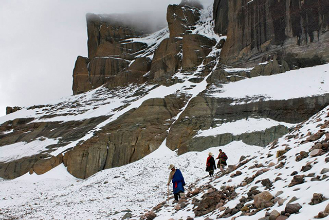 Pilgrims descending from the Cave of Thirteen Golden Stupas on Kailash's southern face